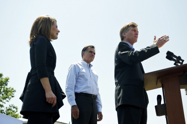 Virginia Governor Bob McDonnell (R) speaks next to U.S. Congresswoman Michele Bachmann (L) and U.S. Republican presidential candidate and former Massachusetts Governor Mitt Romney during a rally at Crofton Industries in Portsmouth, Virginia, in this May 3, 2012 file photo. Virginia is a key battleground in the U.S. presidential race and McDonnell's efforts to move the party to the right in the politically divided state have energized conservative Christians, alienated other voters and made Virginia a focal point in what Democrats call a &quotwar on women&quot by Republicans.