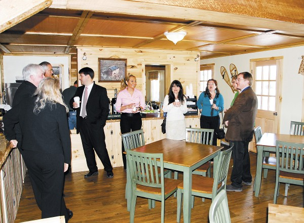 The renovated breakfast room at the Vacationland Inn in Brewer has a rustic and relaxed feel, with knotty wood walls, wood floors, and lauan ceilings. The breakfast room is locally known for its waffles.