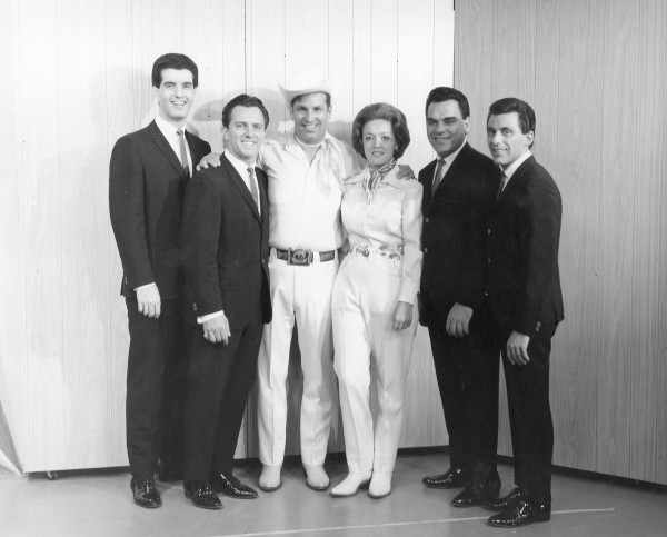 Famous acts often visited the WABI studio during the station's early years. Here, the Four Seasons (with lead singer Frankie Valli at far right) posed with local singers Hal Lone Pine and Betty Cody in 1962.