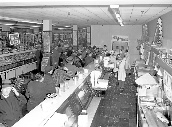 The meat counter at the Columbia Market in Bangor bore more than a slight resemblance to old Mother Hubbard's calorie-barren shelves on Thursday, Feb. 19, 1953 after bargain-hungry residents battled to purchase 12,000 pounds of beef in five hours at prices ranging from nine to 39 cents per pound. According to Albert H. Smaha, manager, the picture above shows the crowd at an ebb. Early arrivals forced the store to open 45 minutes early, he said, and the meat was gone by 1 o'clock in the afternoon. Some people bought as much as 100 pounds after sampling the meat at our counter, Smaha said.