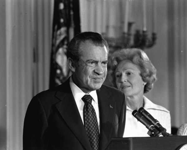 FILE - In this Aug. 9, 1974 black-and-white file photo, President Richard M. Nixon and his wife Pat Nixon are shown standing together in the East Room of the White House in Washington. Thirty-six years after Nixon testified secretly to a grand jury investigating Watergate, a federal judge orders the first public release of the transcript.