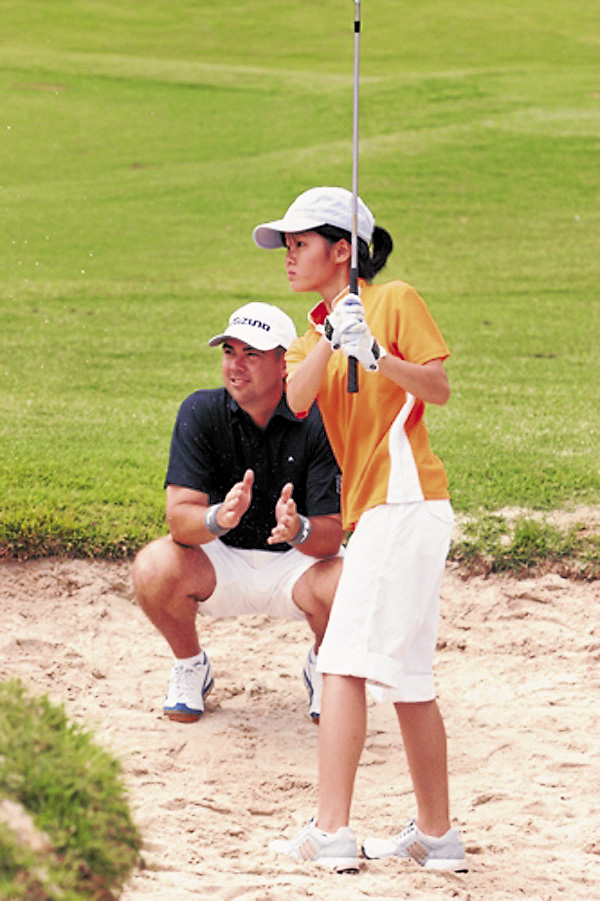 From her coach, a young golfer participating in The First Tee learns the fundamentals of shooting out of a bunker during a class offered by the nationwide program. Bangor Municipal Golf Course will introduce an eight-week First Tee program this summer.