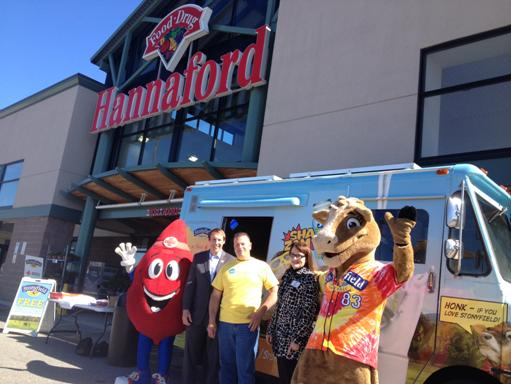 """Buddy the Blood Drop"", Michael Kempesty, Chief Executive Officer, American Red Cross Blood Services Northern New England Region, David Kampner, Community Marketing Manager, Stonyfield, Trish Girard, Assistant Store Manager, Hannaford, and ""Gurt""."