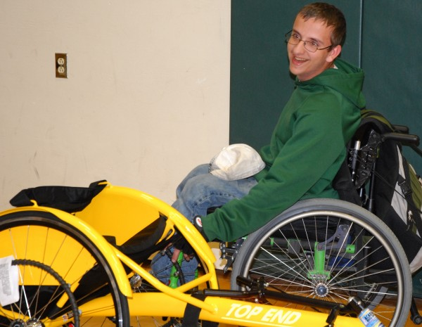 Robbie Hebert is all smiles as he looks over his new racing wheelchair. The member of the Fort Kent Community High School track team was surprised with the chair during an impromptu ceremony Friday at the high school.
