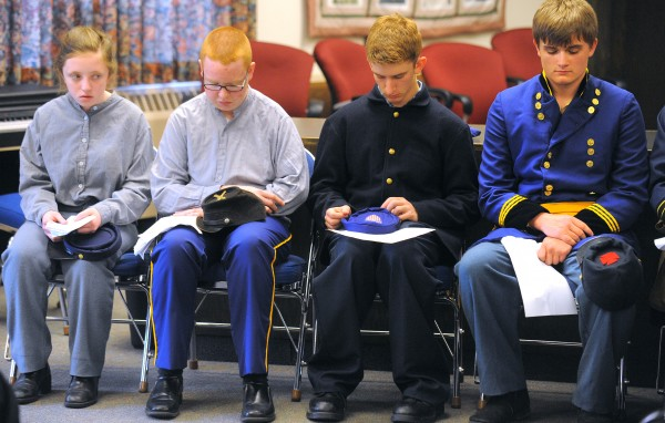Bangor High School students reenacted the funeral of Civil War soldier Sgt. William P. Holden at the Bangor City Hall Friday. About 20 students participated in the reenactment from the theater class and members of the ROTC program performed the flag folding. Sgt. Holden was shot in the head and layed on the battlefield for about a week. He was eventually able to clean his wound some and later received help. He recovered to the point that he was able to walk, but died about nine months later due to fever. The reenactment was done in collaboration with the Bangor Museum and History Center. Nelson Durgin Bangor City Council Chair, Major General, Maine Air National Guard (retired) provided closing remarks to the event. Pictured are from left: Abby Young, Jkob Grey-Purvis, Nick Fournier and Brennan MacDonald.