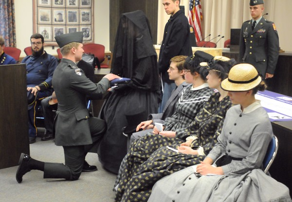 Bangor High School students reenacted the funeral of Civil War soldier Sgt. William P. Holden at the Bangor City Hall Friday. About 20 students participated in the reenactment from the theater class and members of the ROTC program performed the flag folding. Sgt. Holden was shot in the head and layed on the battlefield for about a week. He was eventually able to clean his wound some and later received help. He recovered to the point that he was able to walk, but died about nine months later due to fever. The reenactment was done in collaboration with the Bangor Museum and History Center. Nelson Durgin, Bangor City Council Chair, Major General, Maine Air National Guard (retired) provided closing remarks to the event.