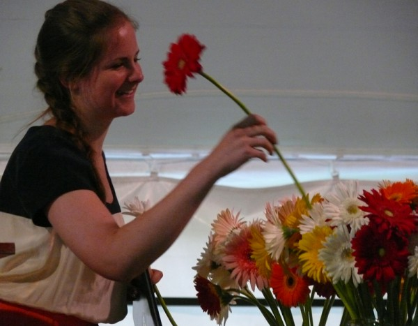 Julia De Santis '12 chooses a flower to give to a classmate during COA's 2012 commencement exercises.