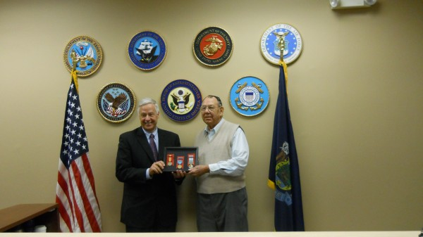 U.S. Congressman Mike Michaud presents military medals to Herbert J. Evans of Levant.