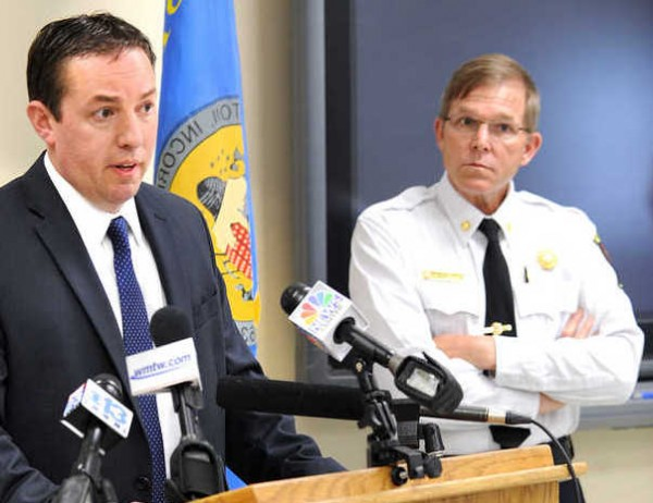 Lewiston Police Chief Michael Bussiere (left) announces that a 12-year-old boy has been charged with arson in connection with the fire in an apartment building on Blake Street in Lewiston on Monday afternoon that spread to two other apartment buildings, displacing 35 families and causing more than a million dollars in damage.