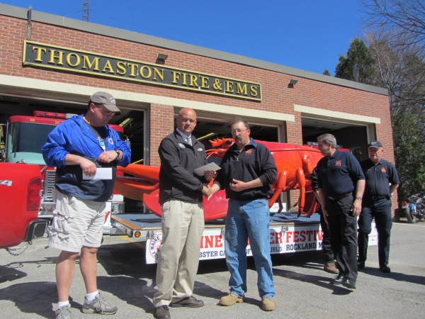 Maine Lobster Festival President Tim Carroll, second from left, presents a $50,000 check to Tony Leo, who is chairman of the Thomaston Fireman's Association committee and is raising money for a new utility truck for the fire department. Also pictured are, from left, Brian Plourde of the Lobster Festival, Fire Chief Mike Leo and Floyd Lawrence of the fire department.