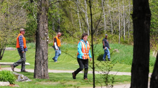 A team of searchers walk in Hudson as they look for missing Nichole Cable, 15, of Glenburn. More than 500 people from law enforcement, search and rescue teams and volunteers participated in the search.