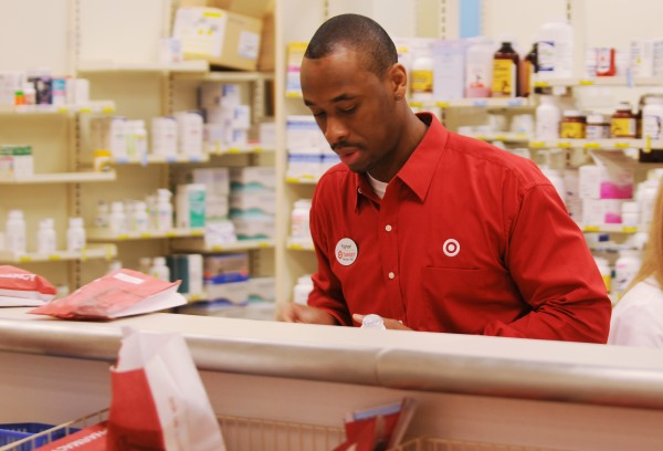 Husson University School of Pharmacy graduate Raphael Dikas of Fort Lauderdale Florida works behind the counter of the Bangor Target pharmacy on Friday, April 26, 2013.