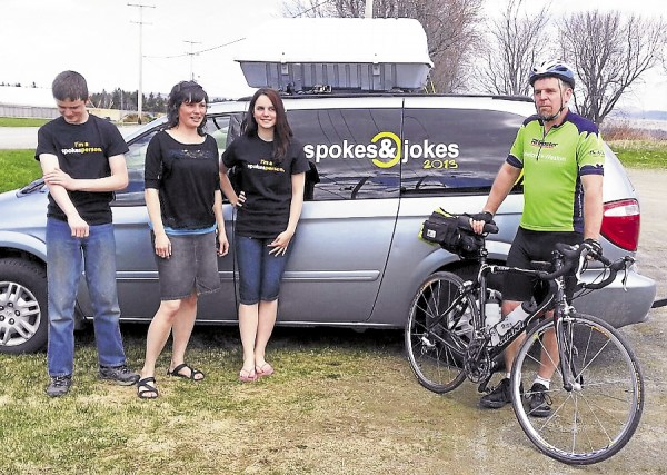 Escorted by his son Jordan, wife Heather and daughter Emma, stand-up comedian and former BDN staffer Chris Quimby left his home in Brooks to pedal to Texas.