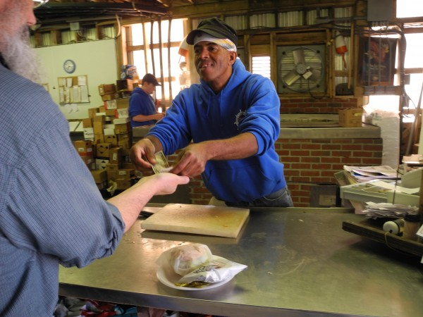 Audley Smith of Kingston, Jamaica, recently started his second season working at Young's Lobster Pound in Belfast. He is one of about eight workers who come to Maine through the H2B visa program. &quotIt's good,&quot he said of his workplace.