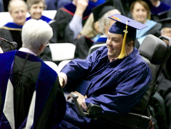 University of Maine, Orono student Derek O'Brien receives his degree during the 2013 graduation ceremony at Alfond Arena Saturday, May 11 2013.