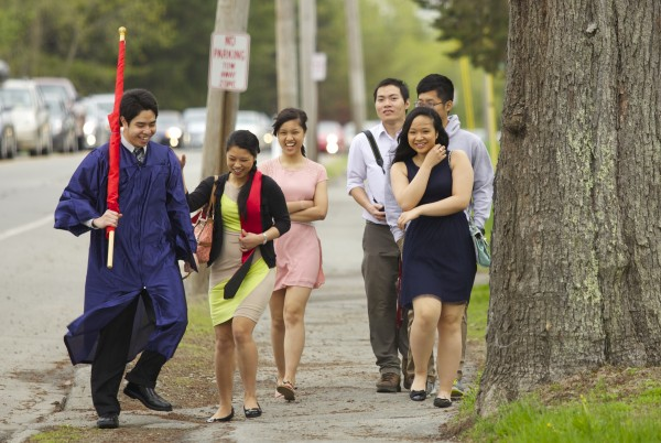 From left, Vu Phan, Giang Vo, Linh Vo, Khai Dang, Ly Nguyen and Phong Nguyen walk to Alfond Arena to attend the 2013 graduation ceremony at University of Maine, Orono Saturday, May 11 2013.
