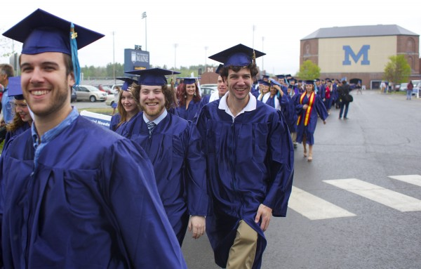 From left, Matt Brown an education major, business majors Mark Miller and Creston Evarts walk to Alfond Arena before the University of Maine, Orono 2013 graduation ceremony at Alfond Arena Saturday, May 11 2013.