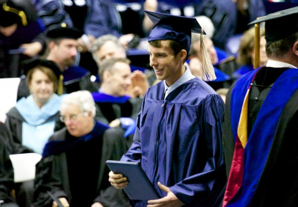 Tyler Mason Walsh, son of Shawn Walsh,  a former UMaine Hockey Coach legend, receives his diploma at the 2013 University of Maine, Orono graduation ceremony at Alfond Arena Saturday, May 11 2013.