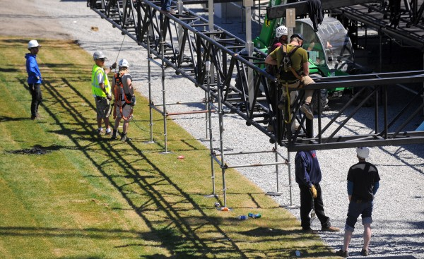 Crews work on assembling the stage at the Bangor Waterfront Friday.