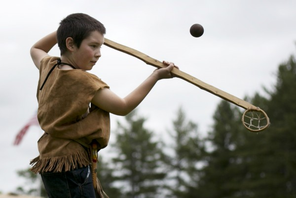 Daniel  Seymour, 11, of Standish, prepares to catch a ball using a replica of an indian lacrosse stick, Saturday, June 8, 2013, in Dayton, Maine.