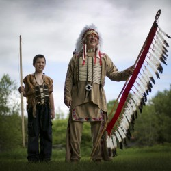 Dan Seymour, of Standish, and his son, Daniel, 11, pose in traditional Indian dress at the Metis of Maine annual pow-wow, Saturday, June 8, 2013, in Dayton.