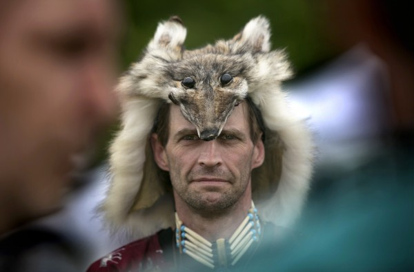 Tom &quotSeeks the Truth&quot Orazio, of Limerick, Maine, wears a wolf headdress before taking part in the Grand Entry at the METIS of Maine pow-wow, Saturday, June 8, 2013, in Dayton, Maine.
