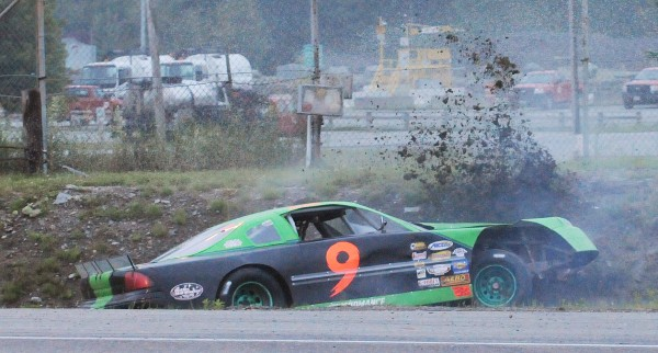 Bradley Norris of Ellsworth crashes his car in turn four during the Darling's Ford Sportsman 25 race at Speedway 95 in Hermon on Saturday night. Norris was able to drive his car out out of the ditch and return to racing.