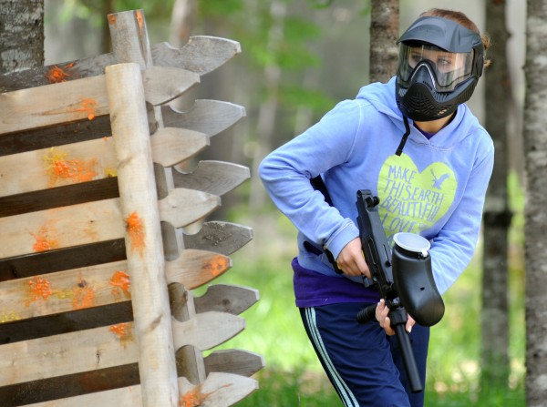Lacey Kalloch prepares to make a move toward the castle during a paintball game on Thursday .
