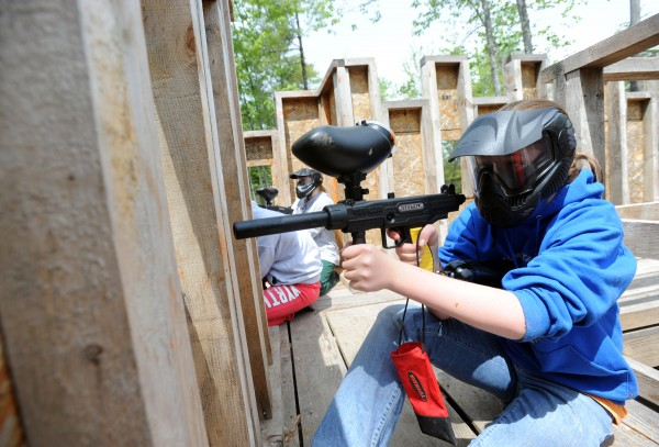 Meg Moulton defends the castle in a girls vs. boys paintball battle on Thursday.
