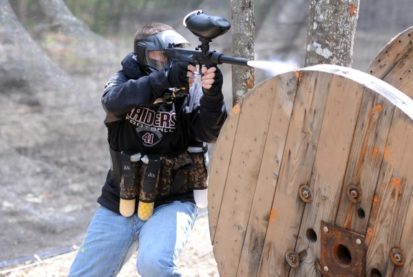 Kade Feeney shoots at opponents during a paintball game on Thursday.