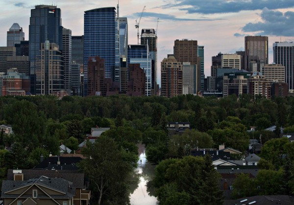A resident (center) walks along a flooded street with the downtown rising in the background, in Calgary, Alberta on Friday. The heaviest floods in decades shut down the Canadian oil capital of Calgary on Friday, forcing the evacuations of tens of thousands of residents and shutting the Alberta city's downtown core
