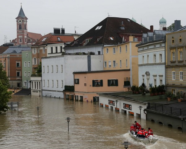 A rescue team on a dinghy evacuates a man from the flooded district of the Bavarian town of Passau, about 124 miles north-east of Munich on Tuesday.