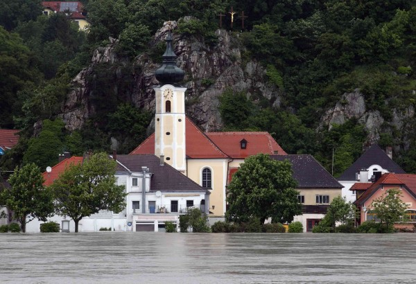 A church stands partially submerged in the flood waters from the swollen Danube river in Marbach, some 56 miles west of Vienna on Monday.