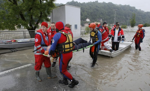 A rescue team evacuates a man on the stretcher in the flooded district of the Bavarian town of Passau, about 124 miles north-east of Munich on Tuesday. Torrential rain in the south and south-east of Germany caused heavy flooding over the weekend, forcing people to evacuate their homes.