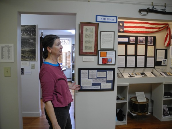 Megan Pinette of the Belfast Historical Museum points out details from the new exhibit on the home front in Belfast during the Civil War.