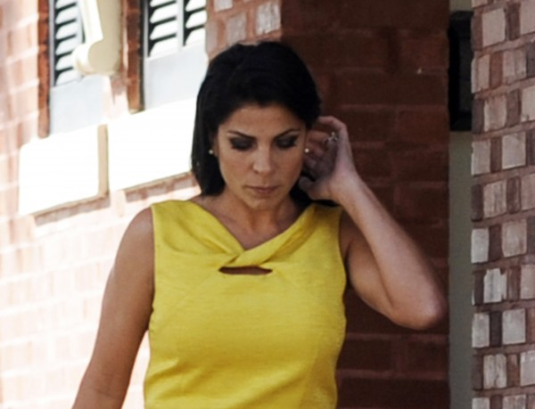 Jill Kelley walks out of her home in Tampa, Fla. on Nov. 12, 2012. Kelley has sued the federal government over alleged privacy violations.