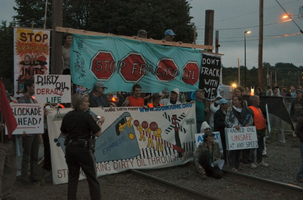 Protesters gather on the railroad tracks near Lawrence Avenue in Fairfield in an attempt to stop a train carrying crude oil on Thursday, June 27, 2013. The train never came and six protesters were arrested for criminal trespassing.
