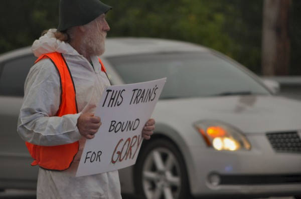 Tom Kemp of Sangerville was one of more than two dozen protesters demonstrating against the railway transportation of crude oil through Maine on Thursday, June 27, 2013. The protesters blocked a railroad crossing on Lawrence Avenue in Fairfield, resulting in the arrest of six protesters.