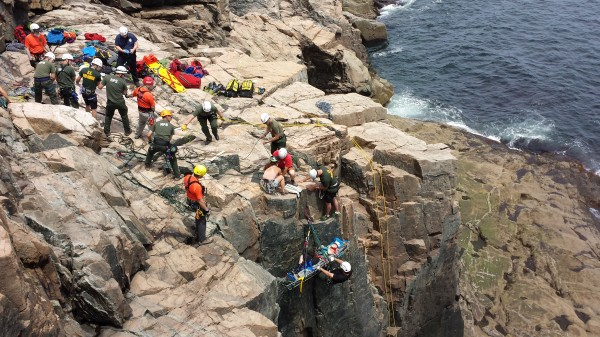 Rescue personnel hoist an injured climber up a rock face at Otter Cliffs in Acadia National Park on Sunday, June 16, 2013. According to park rangers, two climbers were hurt around 10 a.m. when a climbing rope broke, causing two people to fall onto a third. One of the people who fell, a local rock climbing guide, was unhurt in the fall.