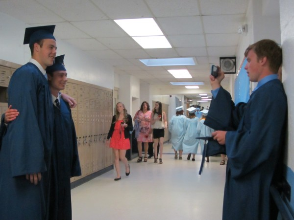 P.J. Spearing takes a photograph of two fellow Oceanside High School graduates -- Tyler Gilson, left, and Aaron Beal, center, shortly before the start of commencement ceremonies Tuesday evening at the Rockland school. Oceanside graduated 152 students.