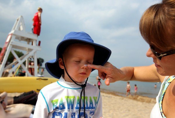 Kristin Conn applies a sunscreen to her son, Merrick, Evanston, Ill., last summer.
