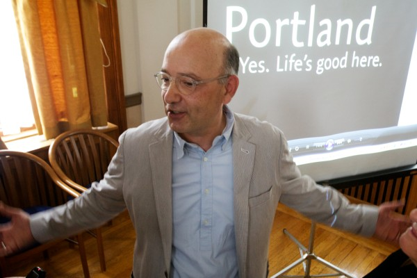 David Puelle of David Puelle Design talks with the press about Portland's news marketing campaign Tuesday at city hall. Puelle had a hand in formulating the new campaign.