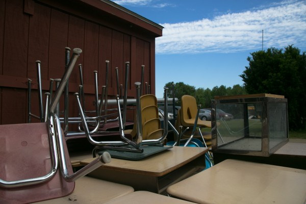 Chairs and desks were stacked outside of Frankfort Elementary School on Friday, June 21, 2013.
