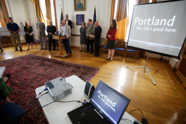 City officials and community members unveil Portland's new branding campaign at city hall Tuesday.