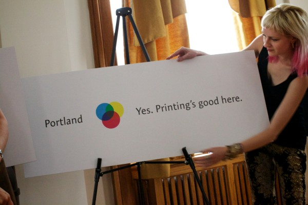 Sarah Harrington unveils a variation on Portland's new branding campaign at city hall Tuesday.
