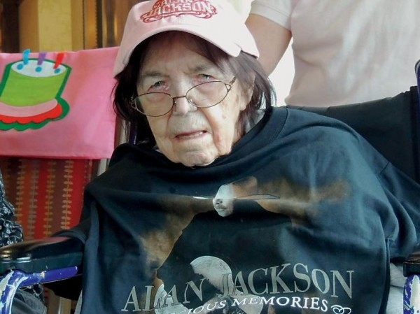 Barbara Bowden, who turned 100 years old on Tuesday, sports a hat and signed T-shirt she received as birthday presents from country music star Alan Jackson.