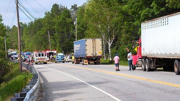 Rescue personnel tend to a Trek Across Maine cyclist on Route 2 in Hanover on Friday morning.