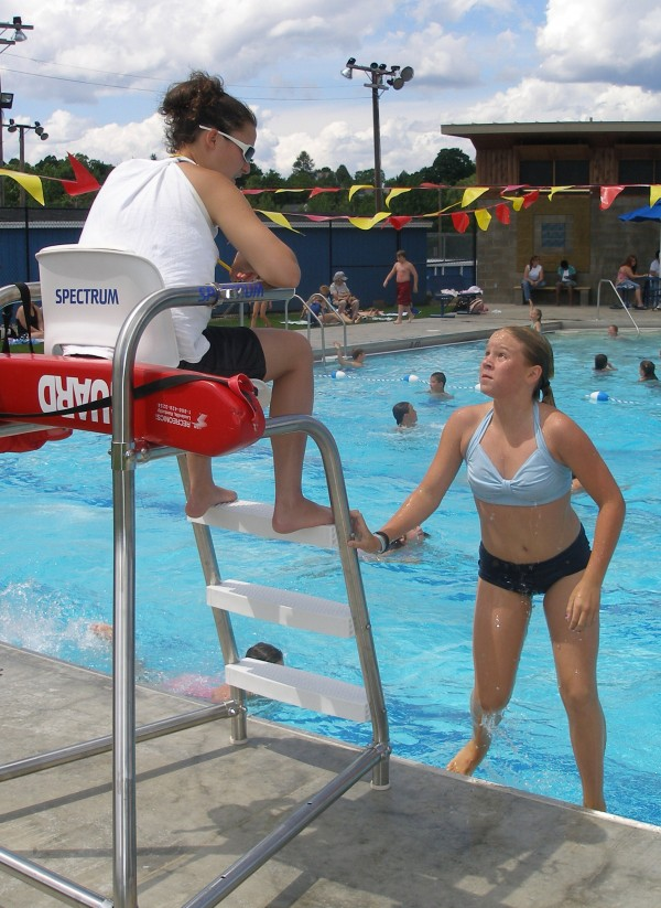 Lifeguard Deanna Michaud, 18, of Millinocket, talks to a swimmer Monday at the Millinocket Community Pool in July 2007. As the summer starts and people head to pools and beaches, it's important to make sure lifeguards have the skills and support they need to keep swimmers safe.