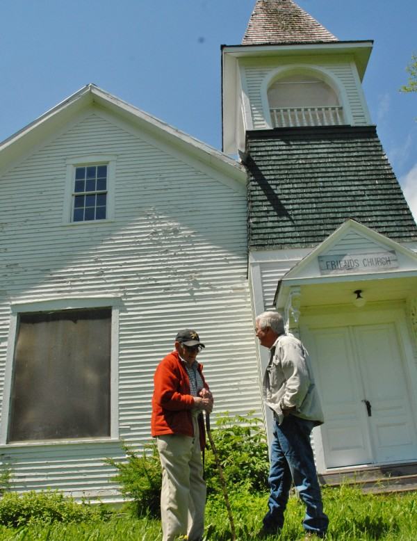 Art Mraz (left) and Jim Everett spend a few moments chatting outside the old Friends Church in Fort Fairfield.