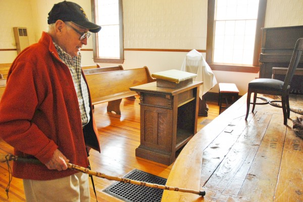 Fort Fairfield historian Art Mraz points out the spot widely considered to be the location of a trap door leading to a hiding spot in the old Friends Church which may have been a stop on the Underground Railroad in the mid 1800s.